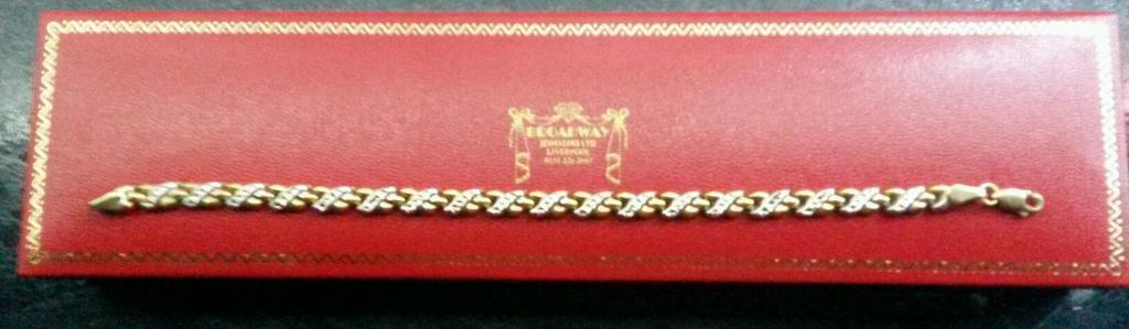 Gold two tone kisses bracelet