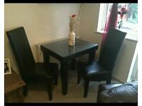 2 Seater glass leather dining room table