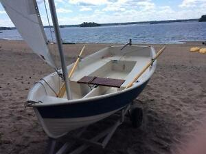 Small Sailboat and Rowboat with Trailer