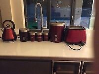 Kettle, toaster, tea, coffee, sugar, bisciot and bread tin