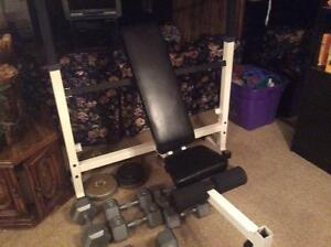 Bench assorted weight plates Dumbbells and bar