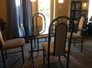 Glass top dining table and 4 chairs,