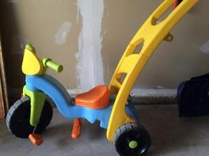 Fisher price tricycle with push handle