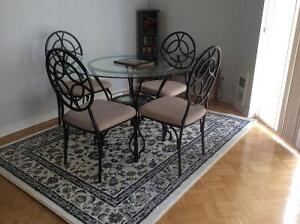 Glass dining room table and 4 chairs $250.00