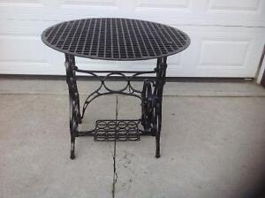 Cast sewing machine table.