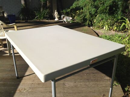 Coleman folding table with custom made marine cover
