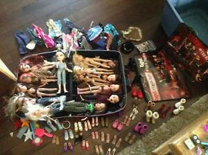 14 BRATZ DOLLS w/accessories & carry case 60.00 obo