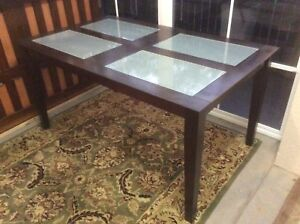 Dining Table with glass top inserts. Bayview Darwin City Preview