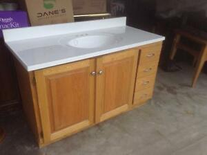 Oak vanity with corian counter sink