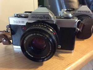 Minolta XG 9 film camera with lens