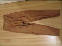 Boutique orange patterned leggings UK8-12