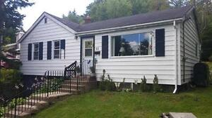 Half acre + lot in Bedford with house