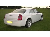 White Chrysler's for wedding and executive hire
