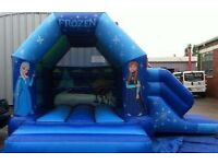 Frozen bouncy castle with side slide