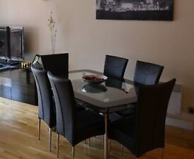 Harvey's dining table with 6 chairs