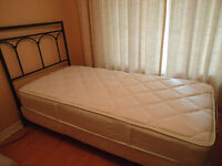 Twin size electric adjustable bed with mattress and headboard