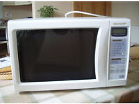 RRP £129.99,Now Only £35,Sharp R-244(W)M Microwave,Sharp R-244,(W)M Microwave,Full Working Order.
