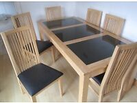 Oak dining table and 6 chairs with granite inlay