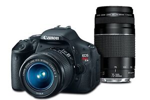 Canon T3i with 18-55mm + 55-250mm lens
