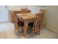 Solid Oak Extending Dining Table + 4 Arched Back Solid Oak and Leather Dining Chair