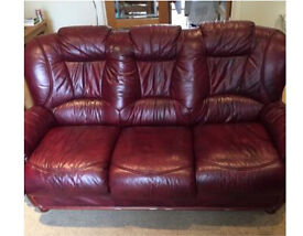 Dark red leather sofa and armchairs
