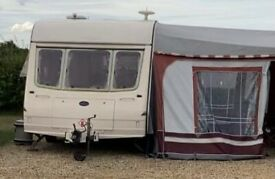 Compact 2 berth caravan with awnings