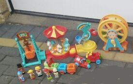 Happyland fairground and big wheel with figures as seen collect or deliver Stonehaven