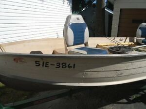 Boat Motor and Trailer. NEW PRICE $1997 FIRM