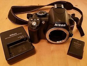 Nikon d3100 body w/ battery and charger SD card and camera bag