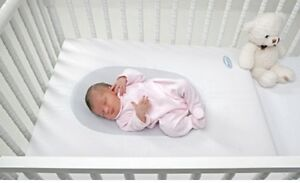 UbiMed Life Nest. Fits all standard cribs.  Up to 6 mths old