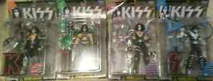 Attention KISS Collectors!4 original KISS figurines,never opened