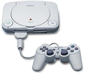 Playstation 1 compact + jeux + 2 manettes + memory card