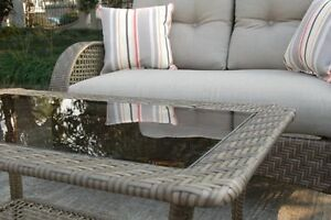 Brown wicker, glass top patio coffee table