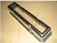 SBC V/8 Valve Covers with the tops cut off.