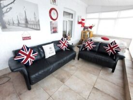 DFS very stylish Black leather cut of arm design 3 seater and 2 seater sofas unusual design