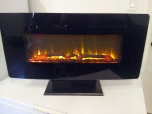 "$250.00obo Muskoka 35"" electric fireplace-curved glass-new cond"