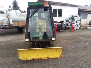 "2002 JD F1145 / 72"" front snow plow and grass cutting unit"