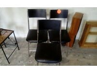 3 metal framed chairs