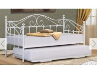 White single day bed with trundle which goes to a double