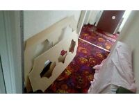 Two decoratively shaped mdf panel..make radiator cover?