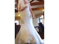 Victoria S fishtail wedding dress with under hooped underskirt