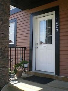Townhouse in Airdrie Close to 3 schools