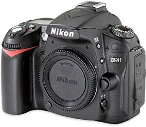 Nikon d90 with lense and backpack.
