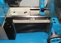 Roll-up safety guard for lathe advancing bars