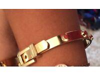 Lost MK gold bracelet