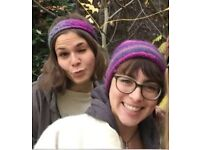 Lost handmade woolen hat (beanie). Dark blue and purple, with a red inner. Lost in Eastbourne!