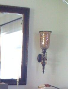 two glass and brass wall sconces