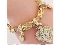THIS IS A BEAUTIFUL GOLD FILLED NEW LADIES BRACELET WITH LOVE HEART QUARTZ WATCH