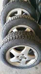 "4 - VW 14"" Alloy Rims (4X100) with Firestone Snow Tires - 185/60 R14"