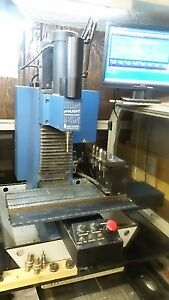 CNC milling machine with 4 tool changer